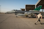 Staff Sgt. Larry Runk, 407th Expeditionary Maintenance Squadron crew chief, walks away from an F-16 Fighting Falcon assigned to the 134th Expeditionary Fighter Squadron after marshaling it for take off at the 407th Air Expeditionary Group, Dec. 29, 2016. Combat missions flown by the fighter squadron have degraded military capabilities of Daesh, also known as the Islamic State, by denying the group safe haven in the region. (U.S. Air Force photo/Master Sgt. Benjamin Wilson)(Released)