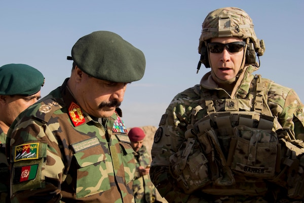 Lt. Gen. Muhammad Waziri, left, 201st Afghan National Army Corps commander, and Train Advise Assist Command-East Command Sgt. Maj. Bryan Barker discuss collective training during an expeditionary advisory package mission in Sarobi district, Afghanistan, Dec. 27, 2016. (U.S. Army photo by Capt. Grace Geiger)
