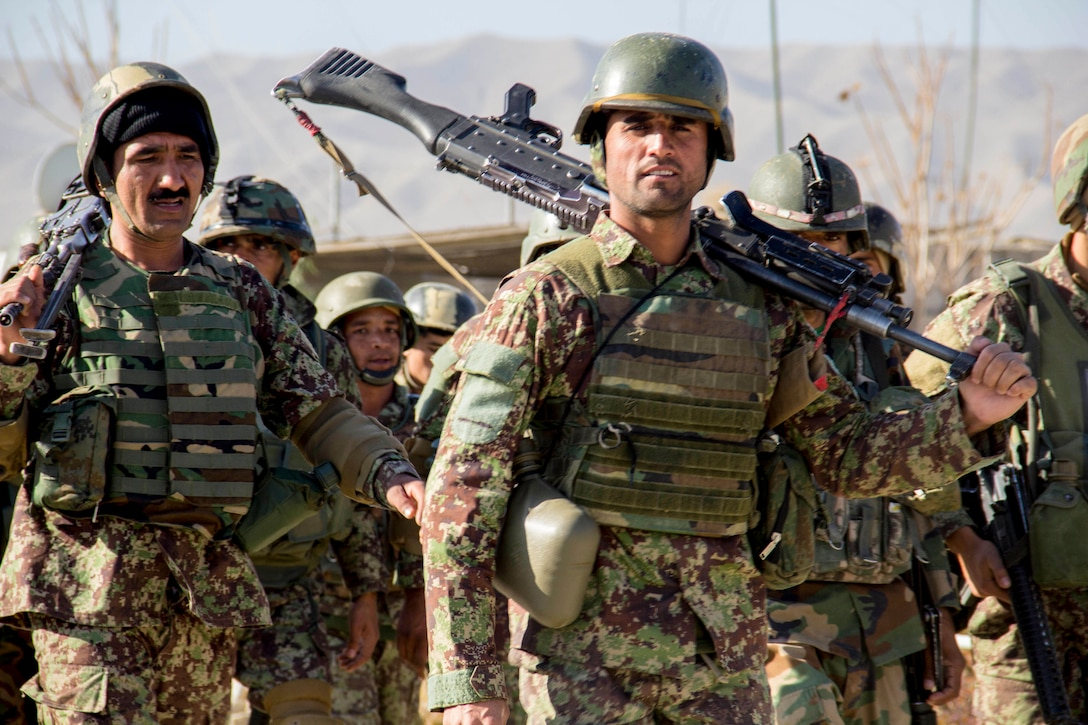 Soldiers assigned to the 201st  Afghan National Army Corps return from conducting collective training near Camp Torah in Sarobi district, Afghanistan, Dec. 27, 2016.  The training was conducted as part of the corps winter campaign strategy designed to build capability and capacity within the organization. (U.S. Army photo by Capt. Grace Geiger)