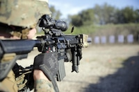 Lance Cpl. Phillip August, a rifleman with Special Purpose Marine Air-Ground Task Force Crisis Response-Africa, fires his weapon during a rifle range near Naval Air Station Sigonella, Italy, Jan. 3, 2017. Marines conducted a stress shoot, which involved a physically strenuous work-out followed by a course of fire aimed at testing the Marine's cognitive function.