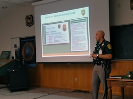 New Hampshire State Trooper Andrew Frigon presents on the N.H. Drug Task Units and observable signs of drug manufacturing and dealing in public places during the annual Ranger Conference on October 25, 2016.