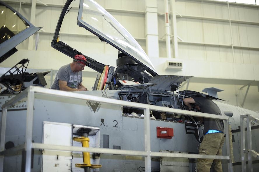 Aircraft technicians from the 309th Aircraft Maintenance and Regeneration Group install a new lightweight airborne recovery system into an A-10C Thunderbolt II at Davis-Monthan Air Force Base, Ariz., Dec. 5, 2016. The LARS V-12 is designed to allow A-10 pilots a more effective means of communication with individuals on the ground such as downed pilots, pararescuemen and joint terminal attack controllers. (U.S. Air Force photo by Airman 1st Class Mya M. Crosby)