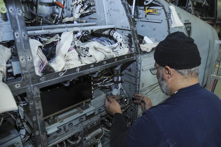 David Antrobus, 309th Aircraft Maintenance and Regeneration Group aircraft technician, installs antenna wires for a lightweight airborne recovery system into an A-10C Thunderbolt II at Davis-Monthan Air Force Base, Ariz., Dec. 5, 2016. The new LARS upgrade provides pilots with GPS coordinates to friendly ground forces and allows them to communicate via voice or text. (U.S. Air Force photo by Airman 1st Class Mya M. Crosby)