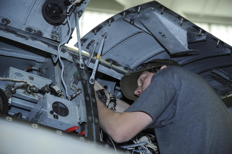 Aaron Miller, 309th Aircraft Maintenance and Regeneration Group aircraft technician, installs a wiring harness for a lightweight airborne recovery system into an A-10C Thunderbolt II at Davis-Monthan Air Force Base, Ariz., Dec. 5, 2016. The LARS V-12 is designed to allow A-10 pilots a more effective means of communication with individuals on the ground such as downed pilots, pararescuemen and joint terminal attack controllers. (U.S. Air Force photo by Airman 1st Class Mya M. Crosby)