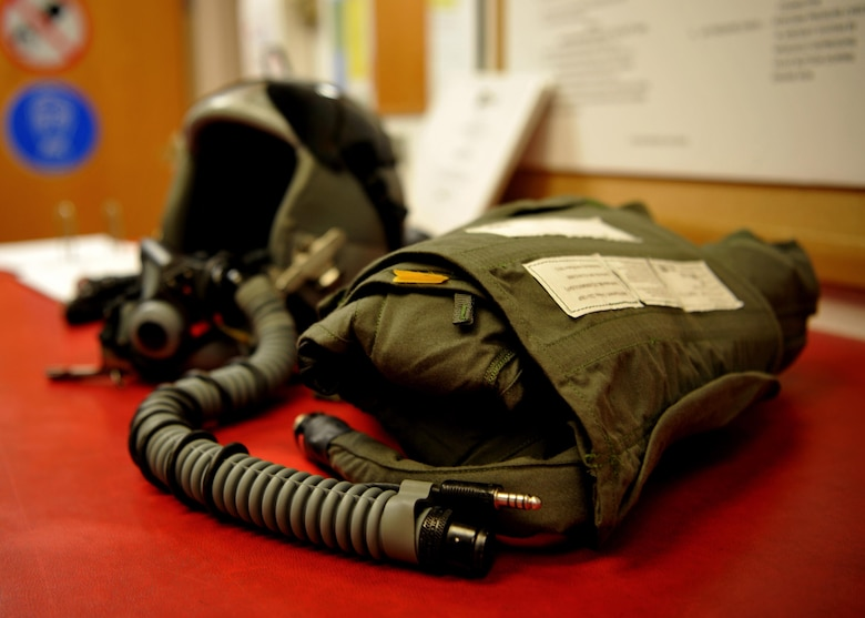 A pilot's helmet, oxygen mask and anti-g suit are pictured Jan. 5, 2016, at Beale Air Force Base, California. The 9th Operational support Squadron aircrew flight equipment is responsible for all of a pilot's gear such as helmet, oxygen mask, harness and all life-saving devices. (U.S. Air Force photo/Staff Sgt. Jeffrey Schultze)