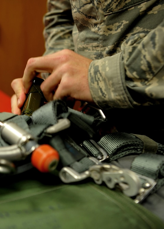 Staff Sgt. Tyler Woodwick, 9th Operational Support Squadron aircrew flight equipment craftsman performs an equipment check on a parachute Jan. 5, 2016, at Beale Air Force Base, California. Aircrew flight equipment personnel manage the inspection, maintenance and adjustments to the devices assigned to the pilots they support. (U.S. Air Force photo/Staff Sgt. Jeffrey Schultze)