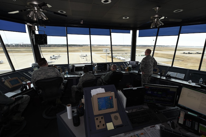 U.S. Air Force Airmen with the 1st Operations Support Squadron man the 1st Fighter Wing air traffic control tower at Joint Base Langley-Eustis, Va., Dec. 16, 2016. Controllers track the departure and arrival times and locations of aircraft, as well as when aircraft are airborne. (U.S. Air Force photo by Staff Sgt. Natasha Stannard)