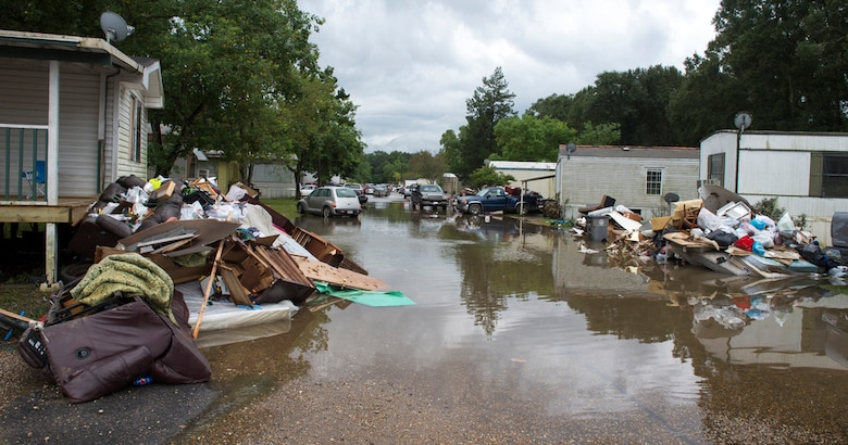 Piles of debris line the side of the roads in flood affected areas one week after the 2016 severe flooding in Baton Rouge, Louisiana.