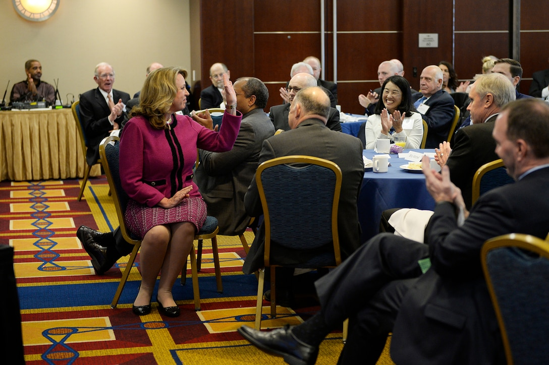 Air Force Secretary Deborah Lee James waves to attendees at the Air Force Association's Breakfast Series in Arlington, Va., Jan. 6, 2017. The Air Force Association's Breakfast Series brings together industry partners, the international attaché corps, and both military and civilian leadership for informative briefings on a monthly basis for updates on relevant current initiatives. (U.S. Air Force photo/Tech. Sgt. Joshua L. DeMotts)