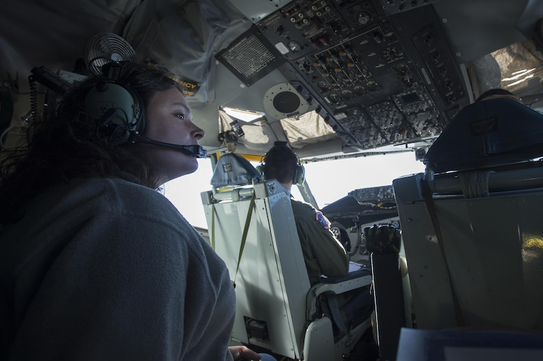 Emily Willhide, Team Shaw spouse, takes in the view from the cockpit of a KC-135 Stratotanker during a collaborative refueling training and spouse flight event at Shaw Air Force Base, S.C., Dec. 21, 2016. Airmen from the 93rd Air Refueling Squadron at Fairchild Air Force Base, Wash., brought the KC-135 to Shaw specifically for this training and utilized the ample space in both the cockpit and main cabin to take multiple Team Shaw spouses on a single spouse flight. (U.S. Air Force photo by Senior Airman Zade Vadnais)