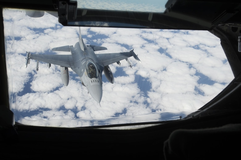 A U.S. Air Force F-16CM Fighting Falcon assigned to the 20th Fighter Wing approaches a KC-135 Stratotanker assigned to the 93rd Air Refueling Squadron from Fairchild Air Force Base, Wash., during collaborative refueling training over the Atlantic Ocean, Dec. 21, 2016. KC-135s are capable of carrying and transferring up to 200,000 pounds of fuel, extending the flying time of aircraft such as the F-16 by eliminating the need for pilots to refuel on land. (U.S. Air Force photo by Senior Airman Zade Vadnais)