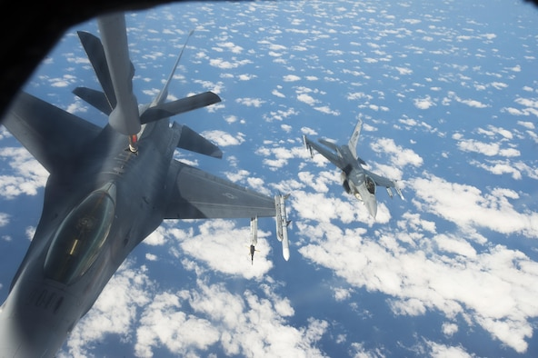 A U.S. Air Force F-16CM Fighting Falcon assigned to the 20th Fighter Wing refuels from a KC-135 Stratotanker assigned to the 93rd Air Refueling Squadron from Fairchild Air Force Base, Wash., as another Team Shaw F-16 approaches over the Atlantic Ocean, Dec. 21, 2016. Airmen from the 93rd RS spent a week at Shaw for collaborative refueling training, giving Team Shaw F-16 pilots the opportunity to practice refueling procedures under various conditions. (U.S. Air Force photo by Senior Airman Zade Vadnais)