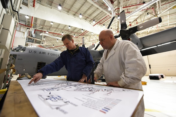 Master Sgt. Roland Selfridge (left), Aircraft Fuel Systems Shop Chief and Master Sgt. Art Fijalkowski, Fuels System Technician, both from the 914th Maintenance Squadron are reviewing a KC-135R fuel system schematic chart and comparing it to a C-130H2 in the fuels hangar at the Niagara Falls Air Reserve Station, N.Y. on January 6, 2017. The air reserve technicians are making preparations for the 914th Airlift Wing's upcoming conversion to the KC-135R Stratotanker. The aircraft in the background is the last scheduled Niagara C-130 to have fuel system maintenance performed on it. The first KC-135R is scheduled to arrive at the base in early February. (U.S. Air Force Photo by Peter Borys)