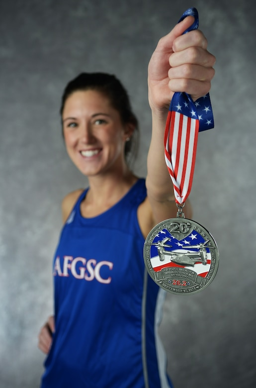 Second Lt. Kimberly Davis, 742nd Missile Squadron missile combat crew member, holds her 2016 Air Force Marathon medal at Minot Air Force Base, N.D., Dec. 15, 2016. Davis has competed in events like swimming in the 2012 U.S. Olympic team trials in Omaha, Nebraska, and running in the 2016 Air Force Marathon in Dayton, Ohio. (U.S. Air Force photo/Airman 1st Class Jonathan McElderry)