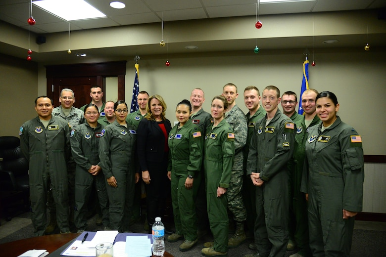 Secretary of the Air Force Honorable Deborah Lee James poses for a photo with missileers at Malmstrom Air Force Base, Mont., Jan. 5, 2017. During her visit, James discussed improvements in morale, innovation and modernization with company grade officers in operations about what changes still need to be considered to improve the nuclear enterprise. (U.S. Air Force photo/Airman 1st Class Magen M. Reeves)