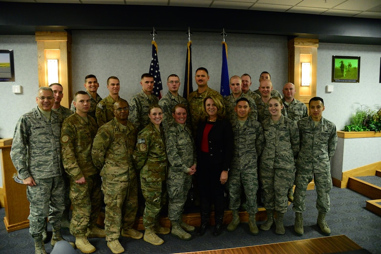 Secretary of the Air Force Honorable Deborah Lee James poses for a photo with enlisted Airmen at Malmstrom Air Force Base, Mont., Jan. 5, 2017. During her visit, James discussed improvements in morale, innovation and modernization with enlisted Airmen from all ranks and squadrons to see what changes still need to be considered to improve the nuclear enterprise. (U.S. Air Force photo/Airman 1st Class Magen M. Reeves)
