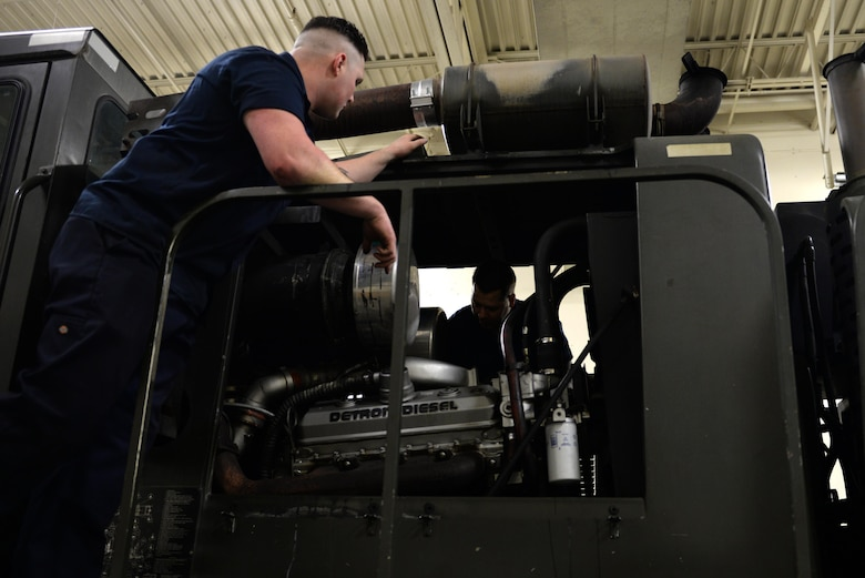 U.S. Air Force Senior Airman Dakota Greenwade, a 354th Logistics Readiness Squadron (LRS) vehicle maintenance technician, consults Staff Sgt. Robert Sommerfeldt, a 354th LRS vehicle maintenance technician during a diagnostic engine test Jan. 6, 2017, at Eielson Air Force Base, Alaska. Sommerfeldt and Greenwade looked for wires and labels to figure out exactly what is wrong with the snow grater. (U.S. Air Force photo by Airman 1st Class Cassandra Whitman)