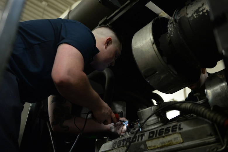 U.S. Air Force Senior Airman Dakota Greenwade, a 354th Logistics Readiness Squadron vehicle maintenance technician, uses a probing wire to diagnose a broken snow grater Jan. 6, 2017, at Eielson Air Force Base, Alaska. Greenwade tested the engine to find why it wouldn't run correctly. (U.S. Air Force photo by Airman 1st Class Cassandra Whitman)