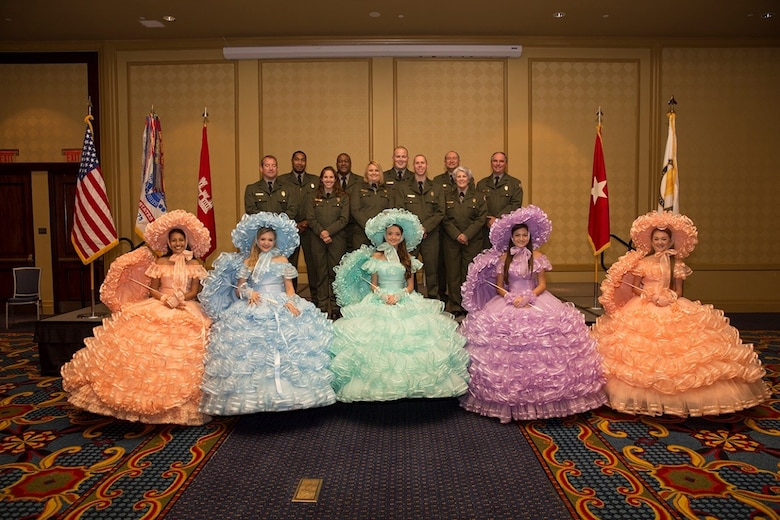 Park Rangers from the U.S. Army Corps of Engineers, Mobile District and Azalea Trail Maids greeted guests at the district Change of Command ceremony earlier this year in June. (Courtesy Photo; Kamryn Harvey pictured middle with green dress)