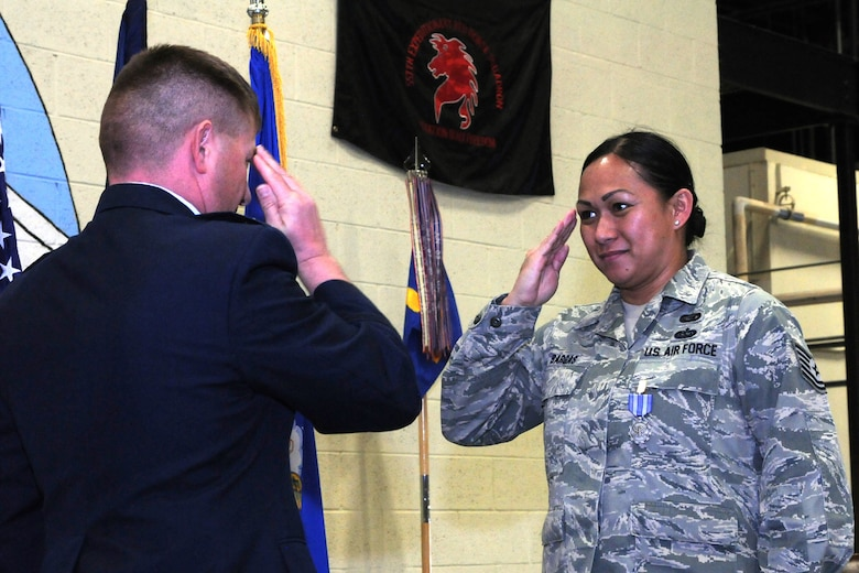 Tech. Sgt. Rhoda Bargas, 219th Rapid Engineering, Deployable, Heavy Operational Repair Squadron Engineer, or RED HORSE Squadron member, salutes 219th RHS Commander, Lt. Col. Rusty Vaira after receiving the Air Force Achievement medal for deployed operations Dec. 4, 2016. The 219th RED HORSE deployed in support of operations Inherent Resolve and Freedom's Sentinel.(U.S. Air National Guard photo/Staff Sgt. Lindsey Soulsby)