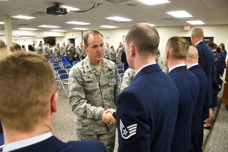 120th Airlift Wing Commander Col. Lee Smith congratulates Staff Sgt. Alexander Jorgenson following the 120th AW NCO Induction Ceremony held on base in Great Falls, Mont. Dec. 4, 2016. (U.S. Air National Guard photo/Senior Master Sgt. Eric Peterson)