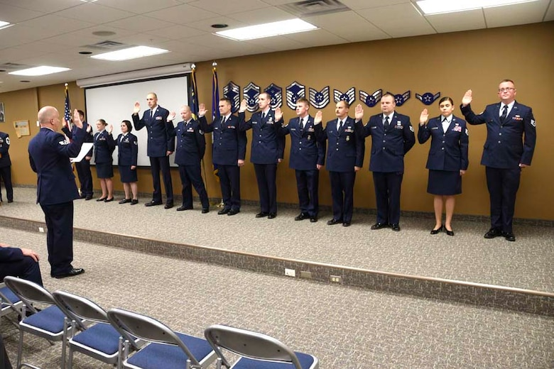 Newly promoted staff sergeants take the oath during the NCO Induction Ceremony held at the 120th Airlift Wing in Great Falls, Mont. Dec. 4, 2016. (U.S. Air National Guard photo/Senior Master Sgt. Eric Peterson)