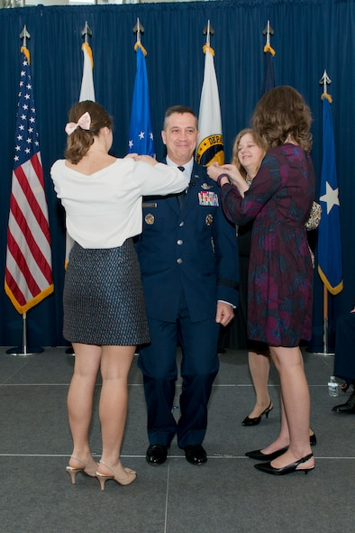 Air National Guard Readiness Center Commander Maj. Gen. Michael R. Taheri, is pinned with his second star during a promotion ceremony January 2, 2017, at Joint Base Andrews, Maryland. Taheri, who has commanded the Readiness Center for the past 18 months, was promoted to the rank of major general. (U.S. Air National Guard photo by Staff Sgt. John E. Hillier)