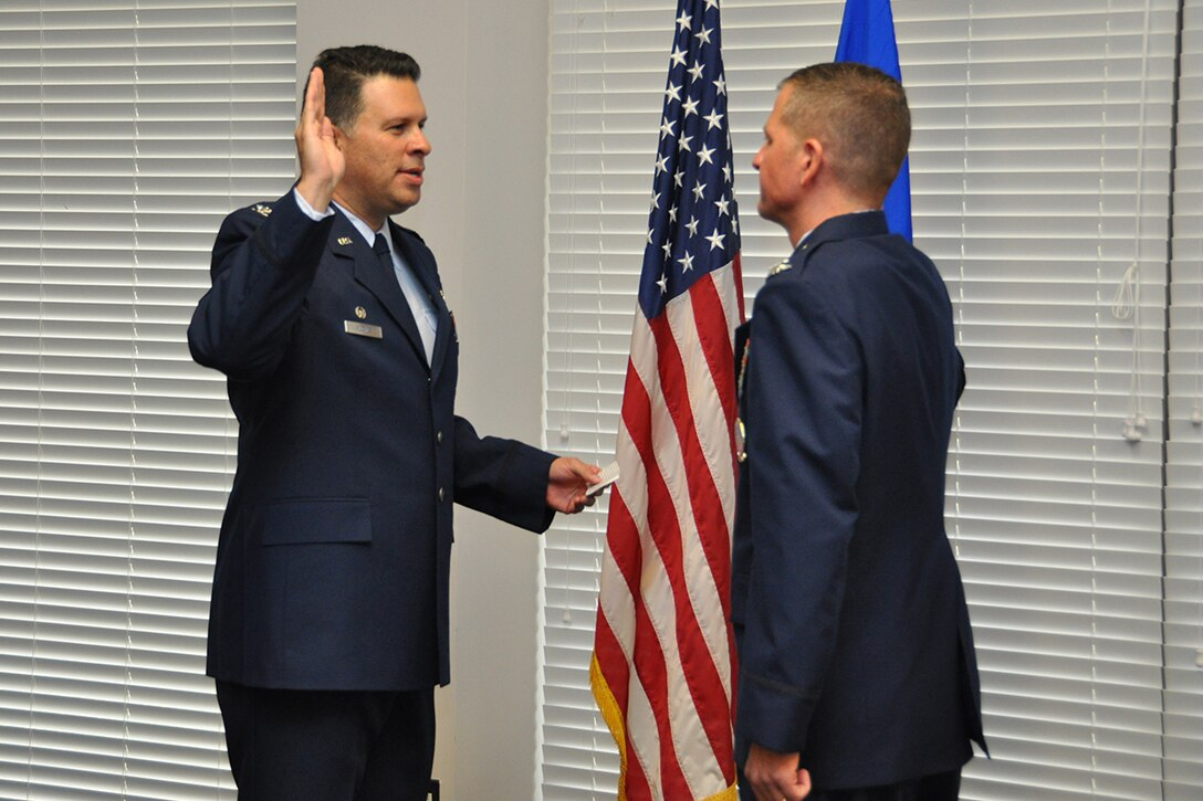 Col. Marty Hughes, 94th Mission Support Group commander, administers the oath of office to Col. Timothy H. Martz, Air Force Reserve Command Recruiting Service vice commander, and former 94th Security Forces Squadron commander, during his promotion ceremony Jan. 4, 2017 at Verhulst Hall, Dobbins Air Reserve Base, Georgia. (U.S. Air Force photo/James Branch)