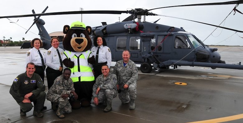 Staff Sgt. Roberto E. Maisonave (first row, third in), a client systems technician with the 920th Mission Support Group Communications Flight, poses with the Seminole County Sheriff's school crossing guards (back row) and 920th RQW safety team (front row). Maisonave designed Carl the Safety Bear which is a large part of a safety initiative in the county. (U.S. Air Force photo by Senior Airman Brandon Kalloo Sanes)