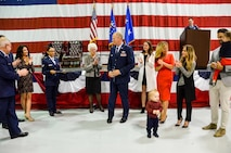 Family members finish pinning the one-star rank insignia onto Brig. Gen. Steven Parker's uniform during a promotion ceremony held at Dobbins Air Reserve Base on Jan. 6, 2017. Parker will be the first one-star general to serve as the 94th Airlift Wing commander since 2006. (U.S. Air Force photo / Tech. Sgt. Kelly Goonan)