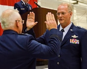 Maj. Gen. John Stokes, 22nd Air Force commander, administers the oath of office promoting Brig. Gen. Steven Parker, 94th Airlift Wing commander, to his new rank, Jan. 6, 2017. (U.S. Air Force photo / Tech. Sgt. Kelly Goonan)