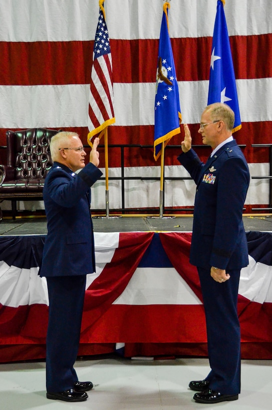 Brig. Gen. Steven Parker, commander of the 94th Airlift Wing and Dobbins Air Reserve Base, takes the oath of office, administered by Maj. Gen. John Stokes, 22nd Air Force commander, in a ceremony at Dobbins Air Reserve Base, Georgia, on  Jan. 6, 2017. (U.S. Air Force photo / Tech. Sgt. Kelly Goonan)