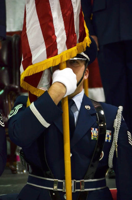 A 94th Airlift Wing Honor Guard Airman holds the American Flag during the beginning of the pinning on ceremony. The commander of the 94th AW and Dobbins Air Reserve Base was promoted to the rank of brigadier general at a ceremony on base Jan. 6, 2017.  (U.S. Air Force photo / Tech. Sgt. Kelly Goonan)