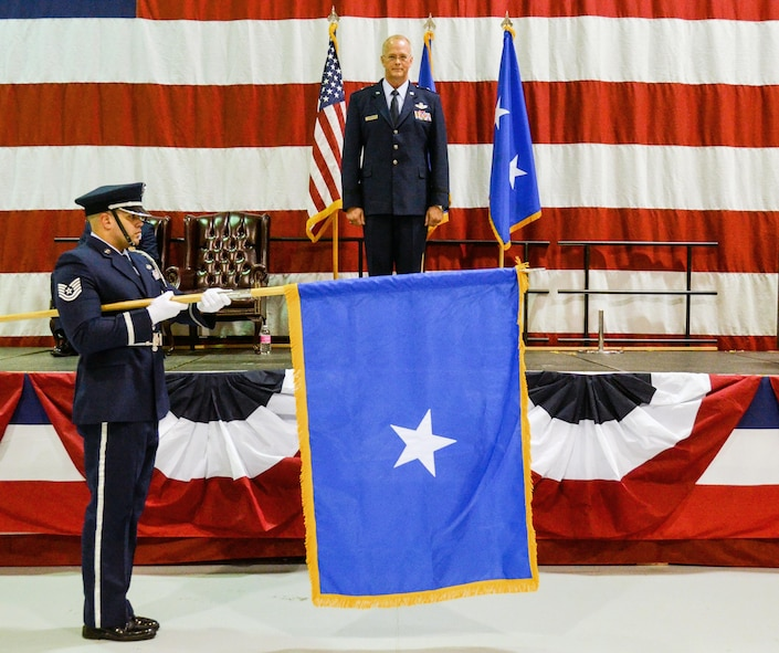 A Dobbins Honor Guard Airman unfurls the one-star general officer flag for Brig. Gen. Steven Parker during the pinning-on ceremony. The commander of the 94th Airlift Wing and Dobbins Air Reserve Base was promoted to the rank of Brig. Gen. at a ceremony on base Jan. 6, 2017. (U.S. Air Force photo / Tech. Sgt. Kelly Goonan)
