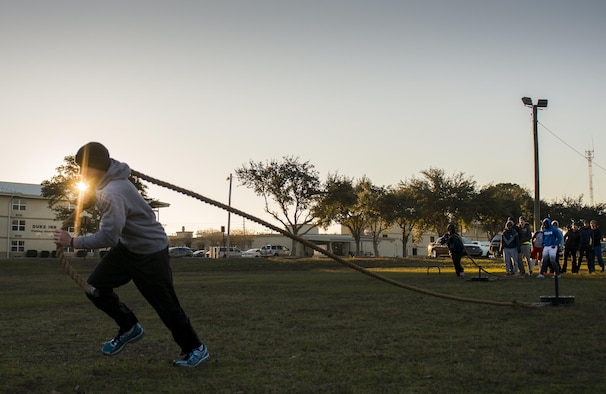 An Airman with the development and training flight pulls a weight sled during a chilly 23 degree morning physical training session Jan. 8 at Duke Field.  The Airmen within the flight attend the monthly training assembly and learn about the Air Force and Reserve prior to going to basic military training.  (U.S. Air Force photo/Tech. Sgt. Sam King)