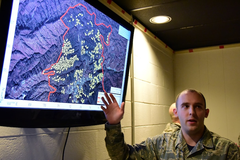 Staff Sgt. Nicholas, a member of the 236th Intelligence Support, presents a map of the fires in east Tennessee on Jan. 7, 2017 a Berry Field Air National Guard Base in Nashville, Tenn. The 236th IS provided valuable imagery and mapping support to the Tennessee Emergency Management Agency and other civilian agencies fighting the fires.