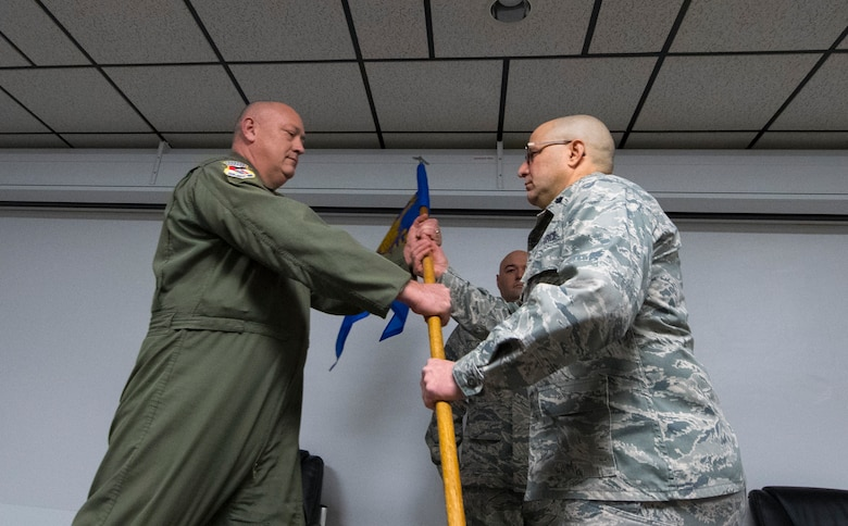 Lt. Col. J.D. Underwood accepts the 130th Medical Group guidon from 130th Airlift Wing Commander Col. Johnny Ryan during the change of command ceremony, Jan. 8, 2017, at McLaughlin Air National Guard Base, Charleston, W.Va. Lt. Col. Underwood assumed command from Col. Kurt Minne. (U.S. Air National Guard Photo by Tech. Sgt. De-Juan Haley)