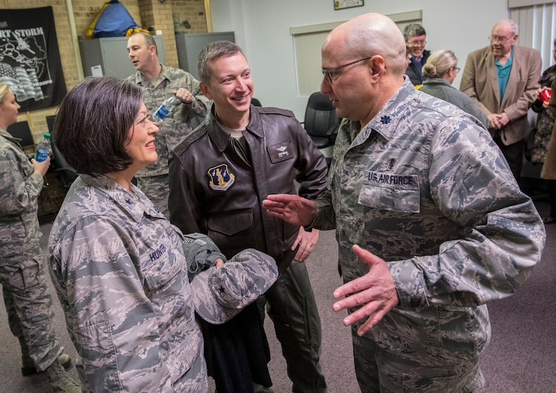 Lt. Col. J.D. Underwood talks with Brig. Gen. Paige Hunter, commander of the West Virginia Air National Guard, and Lt. Col. Mark McDaniel, 130th Medical Group flight surgeon after assuming command of the 130th MDG, Jan. 8, 2017 at McLaughlin Air National Guard Base, Charleston, W.Va. Underwood previously served as the senior administrator for the 130th MDG prior to taking command. (U.S. Air National Guard photo by Tech. Sgt. De-Juan Haley)