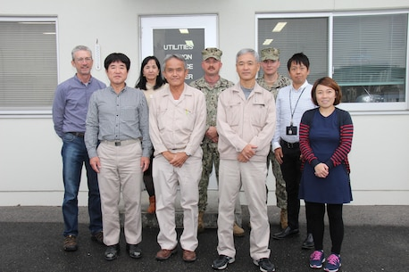 Utilities and Energy Management personnel posed for their annual office photo at Marine Corps Air Station Iwakuni, Japan, 2016. The team helped MCAS Iwakuni reach gold-installation status for the Secretary of the Navy Energy and Water Management Award by submitting data of the air station's utility and energy consumption to Headquarters Marine Corps. MCAS Iwakuni earned the title for the second year in a row for efficiently conserving energy. (courtesy photo)