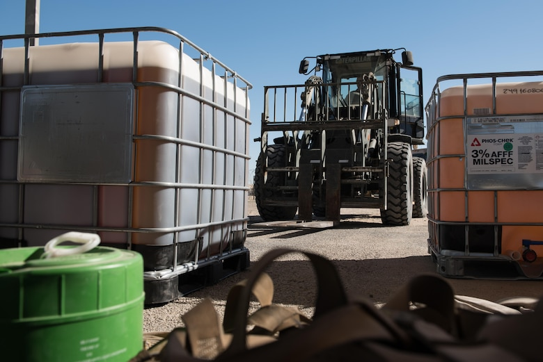 Tech. Sgt. Nathan Darke, 407th Expeditionary Civil Engineer Squadron firefighter, uses a forklift to transport a container of old fire retardant foam at the 407th Air Expeditionary Group, Jan. 6, 2016. The unit switched to a new fire retardant foam in their foam trailer, and six crash vehicles.  (U.S. Air Force photo/Master Sgt. Benjamin Wilson)(Released)