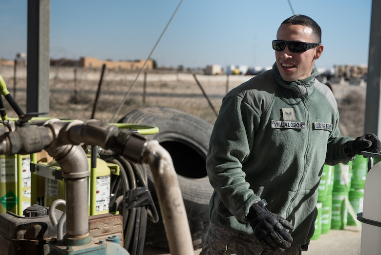 Senior Airman Francisco Villalobos, 407th Expeditionary Civil Engineer Squadron firefighter, transfers fire retardant from a foam trailer at the 407th Air Expeditionary Group, Jan. 6, 2016. The unit switched all the fire retardant foam in their inventory as part of an Air Force-wide initiative to use more environmentally friendly foam. (U.S. Air Force photo/Master Sgt. Benjamin Wilson)(Released)