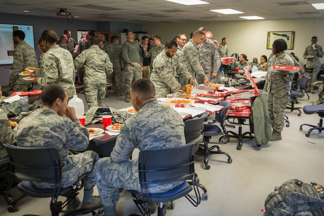 Airmen from the 315th Airlift Wing Security Forces Squadron enjoyed a pizza luncheon Jan. 6, 2017 at Joint Base Charleston.   A Charleston area church provided the pizza, which is a show of support for deploying Airmen and led by the 315th AW Chaplaincy Service.  (U.S. Air Force photo by Master Sgt. Shane Ellis)