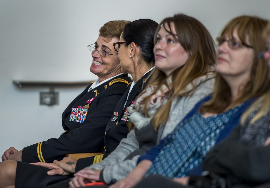 Chief Warrant Officer 5 Mary Alice Hostetler (far left) and Brig Gen. Marion Garcia, commanding general, 200th Military Police Command, share a moment at the Women's Millitary Memorial on Jan. 7 in Arlington, Virginia. Hostetler enlisted into the Army in July 1976 and was promoted to CW5 in April 2013 as the Command Chief Warrant Officer of the 200th Military Police Command. Hostetler served more than 40 years in the United States Army. Hostetler accomplished many milestones, from being the first female in a military police company, the first female to provide protective services in a combat zone, to leading a team in charge of protecting the Secretary of Defense. Hostetler says of all the things she's done in her career, the best thing she's ever done was wear the Army uniform. (Army Reserve Photo By: Sgt. 1st Class Sun Vega)