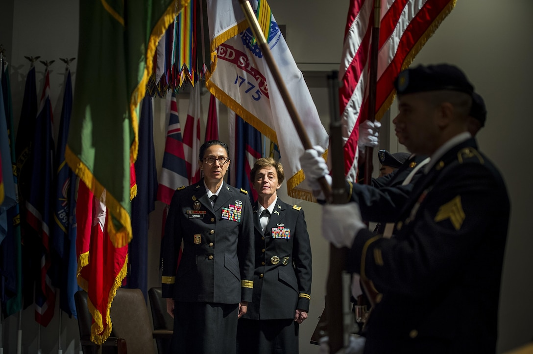 Brig. Gen. Marion Garcia, commander, 200th Military Police Command and Chief Warrant Officer 5 Mary Alice Hostetler stand for the posting of the colors during Hostetler's retirement ceremony at the Women's Millitary Memorial on Jan. 7 in Arlington, Virginia. Hostetler enlisted into the Army in July 1976 and was promoted to CW5 in April 2013 as the Command Chief Warrant Officer of the 200th Military Police Command. Hostetler served more than 40 years in the United States Army. Hostetler accomplished many milestones, from being the first female in a military police company, the first female to provide protective services in a combat zone, to leading a team in charge of protecting the Secretary of Defense. Hostetler says of all the things she's done in her career, the best thing she's ever done was wear the Army uniform. (Army Reserve Photo By: Sgt. 1st Class Sun Vega)