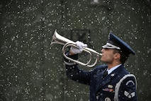 Airman 1st Class Avery Friedman, a 106th Rescue Wing Honor Guard member, performs taps at F.S. Gabreski Air National Guard Base, Westhampton Beach, N.Y., Dec. 15, 2016. (US Air National Guard/Staff Sgt. Christopher S. Muncy)
