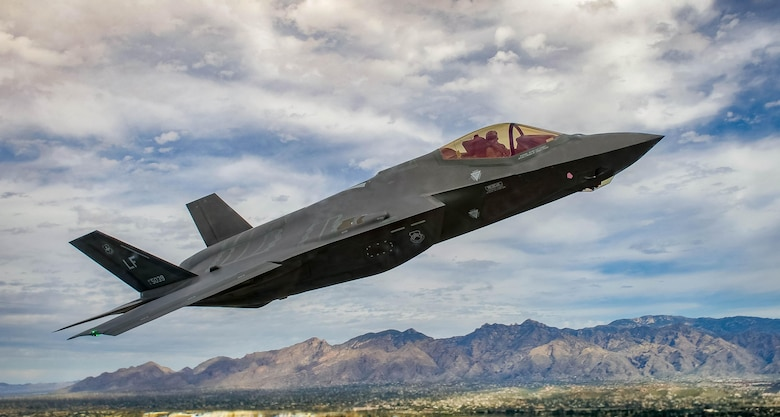 An F-35 Lightning II flies around the airspace of Davis-Monthan Air Force Base, Ariz., March 5, 2016. The F-35 was participating in Air Combat Command's Heritage Flight Training Course, a program that features modern fighter and attack aircraft flying alongside Word War II, Korean War and Vietnam War-era aircraft. (U.S. Air Force photo/Tech. Sgt. Brandon Shapiro)