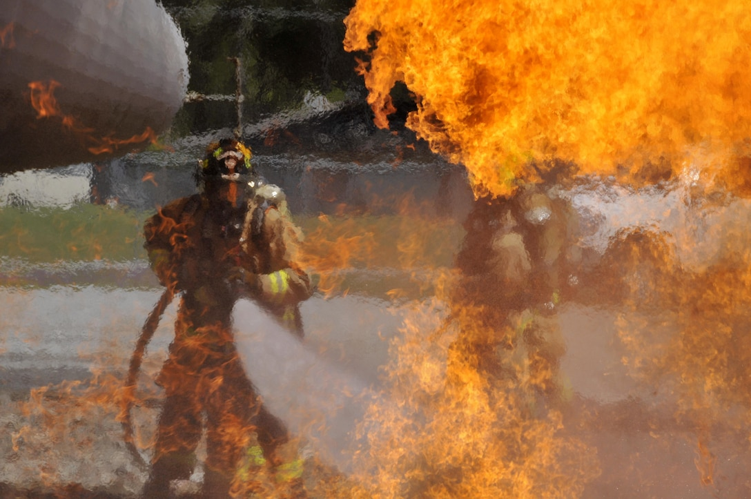 Airmen from the Connecticut, Maine, New Jersey, Rhode Island, and Vermont Air National Guard fire departments perform a live aircraft fire training exercise at 165th Airlift Wing's Regional Fire Training Facility in Savannah, Ga., April 4, 2016. The Airmen conducted joint training exercises to maintain operational readiness. (U.S. Air National Guard photo/Tech. Sgt. Andrew J. Merlock)