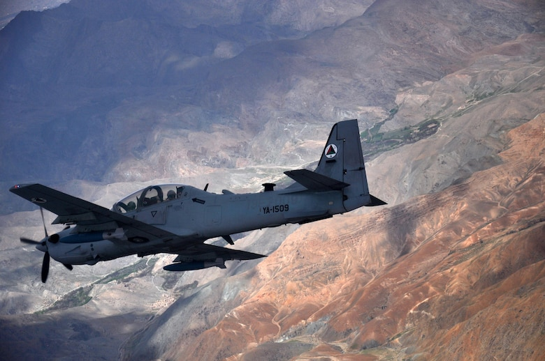 An A-29 Super Tucano flies over Afghanistan during a training mission April 6, 2016. The A-29 is a light attack aircraft that can be armed with two 500-pound bombs, twin .50-caliber machine guns and rockets. Aircrews are trained on aerial interdiction and armed overwatch missions that enable a pre-planned strike capability. The Afghan air force currently has eight A-29s but will have 20 by the end of 2018. Train, Advise, Assist Command-Air (TAAC-Air) works daily with the Afghan air force to help build a professional, sustainable and capable air force. (U.S. Air Force photo by Capt. Eydie Sakura/released)