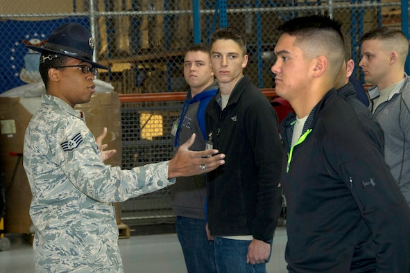 SCHRIEVER AIR FORCE BASE, Colo. -- Delayed Enlistment Program trainees listen carefully as former Military Training Instructor, Staff Sgt. Matthew Coleman-Foster, speaks to them Saturday, Jan. 7th, 2017. Staff Sgt. Coleman-Foster assisted in teaching the DEP trainees important drill and ceremony techniques that they will utilize in Basic Military Training. (U.S. Air Force photo/Staff Sgt. Christopher Moore)