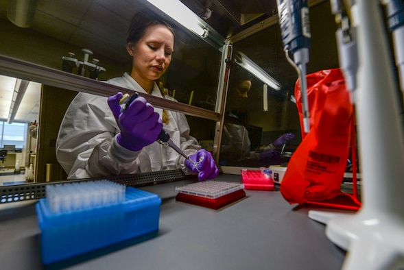 Marie Powell, general supervisor of molecular diagnostics, draws human biological samples before testing them for the Zika virus at the Epidemiology Lab at Wright-Patterson Air Force Base, Ohio, April 20, 2016. The Aedes mosquito can spread serious diseases such as dengue fever, yellow fever, the Zika virus and chikungunya. (U.S. Air Force photo/Master Sgt. Brian Ferguson)